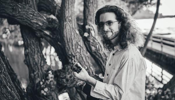 brad bordessa black and white holding ukulele