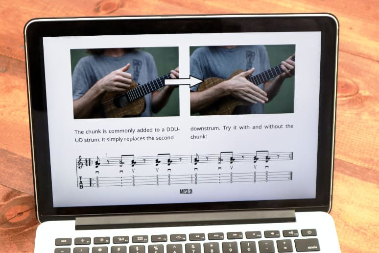 right hand technique for ukulele displayed on laptop