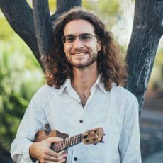 brad bordessa holding ukulele white aloha shirt