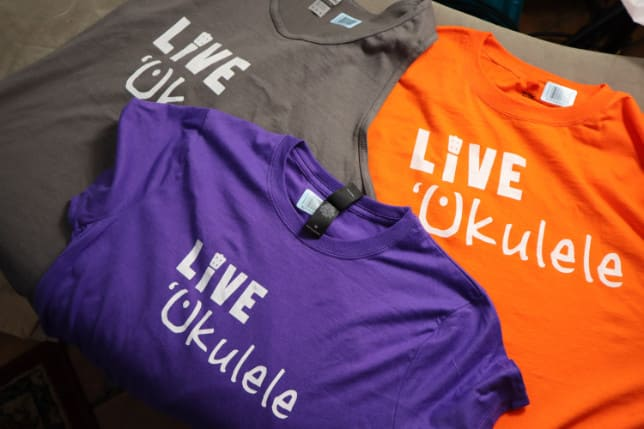 live ukulele brand t shirts in a pile