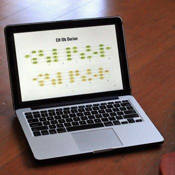 laptop showing ukulele scales