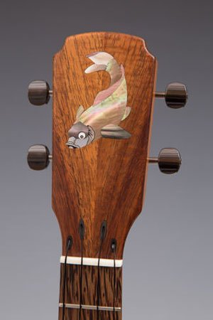 string through headstock design with koi on front