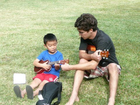 teaching kid to play ukulele