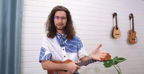 wide angle camera view of ukulele lesson