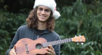 man wearing santa hat with ukulele